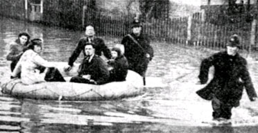 1947 flood. Police Officers help rescue residents in Deans Walk, Gloucester   using a Royal Air Force dingy. (Gloucestershire Police Archives URN 2609)