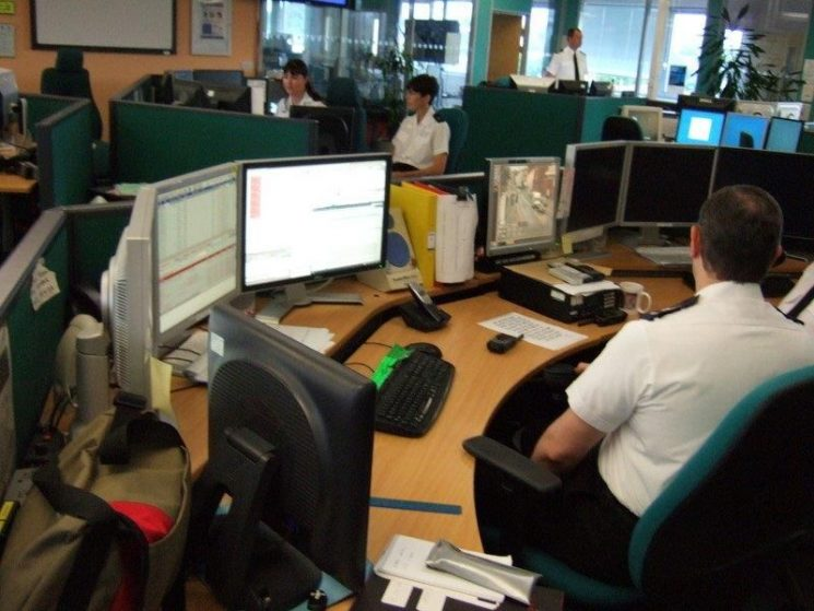 Force control Room 2010 Inspector Simon Todd standing Operator on Far left Kirsty Lewis. (Gloucestershire Police Archives URN 2637)