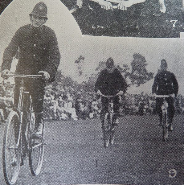 Gloucestershire Police sports day 29 August 1925. Police Constable J.S Clarke winning the one mile bicycle handicap in full uniform. (Gloucestershire Police Archives URN 2621)