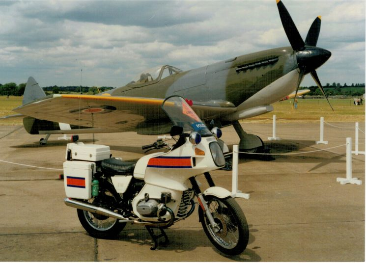 1986 Royal International Air Tattoo at RAF Fairford. A Gloucestershire Constabulary BMW R80RT registration number  A442LAD, posing with Spitfire TE311. This is a Spitfire mark XVI, that  flies with the Battle of Britain Memorial Flight. (Gloucestershire Police Archives URN 2752) | Photograph from Martyn Hillier