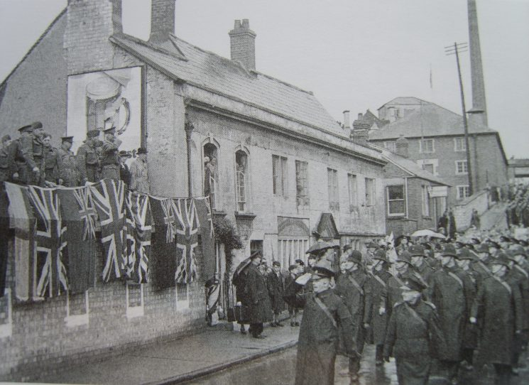 Police contingent marching from Lansdown to Stroud Rugby Ground at Lightpill, during War Weapons week to raise funds for a Spitfire aircraft. Inspector Ted Herbert leading the parade, Police Sergeant Crowther in front rank on left, to his right Police Constable  Arthur Cleveland and Police Constable  Les Rowell 1941 (Gloucestershire Police Archives URN 2631)