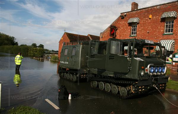 Water and electricity has been shut off from the residents of Tewkesbury due to floods, police use amphibious vehicles to deliver water to stranded residents. Nearly a week after the rain deluge across central and southern England, the EA said six severe flood warnings and 20 flood warnings remain in place as hundreds of people are forced to seek shelter in emergency accommodation. Running water is being restored to 10,000 homes in Gloucestershire but residents have been warned it is not safe to drink. In the towns of Cheltenham, Tewkesbury and Gloucester, residents have been warned that clean water could be unavailable for two weeks. (Gloucestershire Police Archives URN 2600)