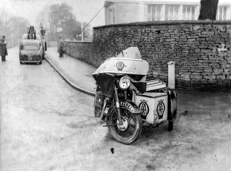 Accident involving a car and an AA patrol. One bent AA motorcycle and sidecar. he junction of the Cirencester Road, Moorend Road. and Lyefield Rd West, Charlton Kings. (Gloucestershire Police Archives URN 2793) | Photograph from an old negative