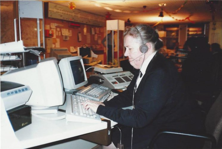 Force control Room Elizabeth Forbes Civilian operator   1992 The long board on the opposite wall is the motorway display as at that time the Motorway SOS boxes were answered in the Police Force Control Room. (Gloucestershire Police Archives URN 6039) | Photograph from Wayne Freeth-Selway
