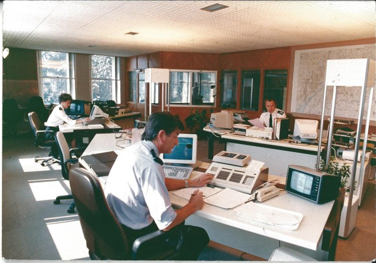 County Police Headquarters Force Information Room Holland House Lansdown Road, Cheltenham  late 1980s . This was after the  refurbishment of the 1970s and before the one in 1990. Inspector Jeremy Taylor with two radio operators. (Gloucestershire Police Archives URN 750)