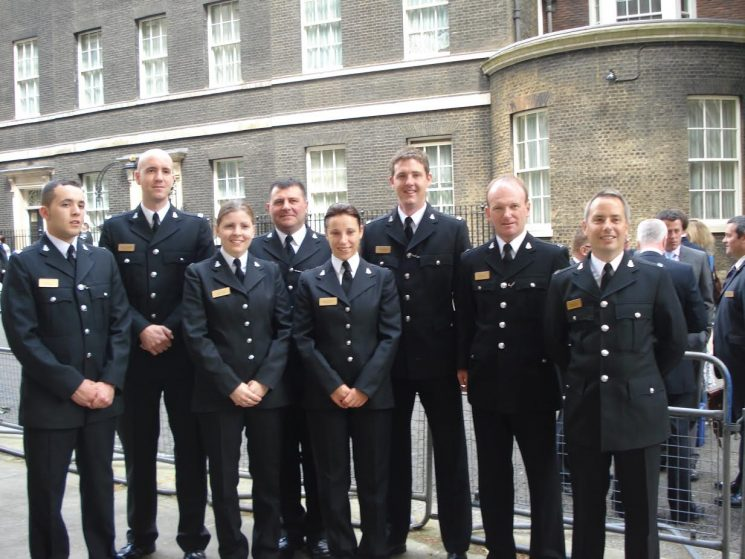 Officers in Downing Street for bravery awards 2008. From left to right are – Ben Hall, Tim Pragnell, Ruth Lamb, Sergeant Clive Patterson , Michelle Openshaw, Adam Chalkley, Rob Dike and Mark Avery. (Gloucestershire Police Archives URN 6021 ) | Photograph from Rob Dike