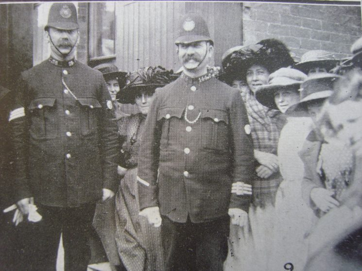Sergeant 28 John Brooks and Police Constable 144 Frederick Ball guarding the gates of Gloucester Vinegar Factory works  during staff strike 02-09-1912. (Gloucestershire Police Archives URN 3593)