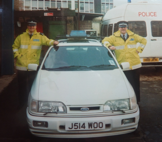 Ford Sierra Cosworth Traffic car a demonstrator for Gloucestershire Traffic. Photographed with temporary blue light and marking. Police Constables Meredith and Batham 1992. (Gloucestershire Police Archives URN 3681)