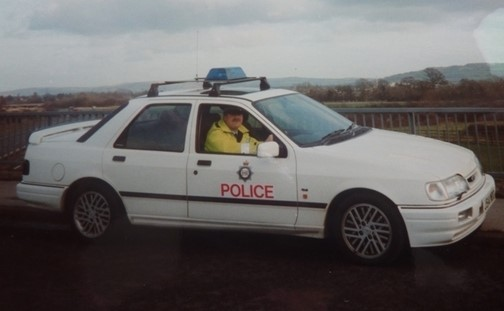 Ford Sierra Cosworth Traffic car a demonstrator for Gloucestershire Traffic. Photographed with temporary blue light and marking. 1992. (Gloucestershire Police Archives URN 3682 )