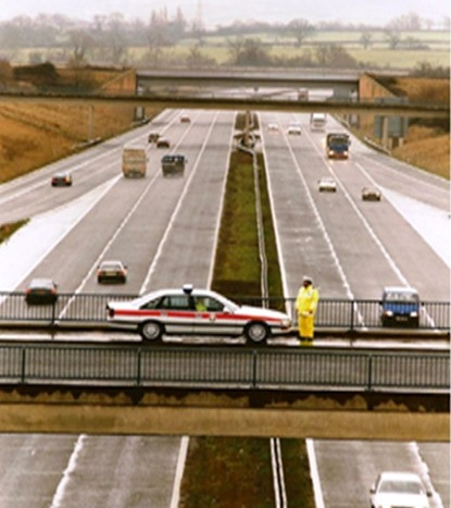 Bamfurlong Motorway unit officers on top of Junction 11 of M5. Police Constable Gary Dean outside. (Gloucestershire Police Archives URN 3725)