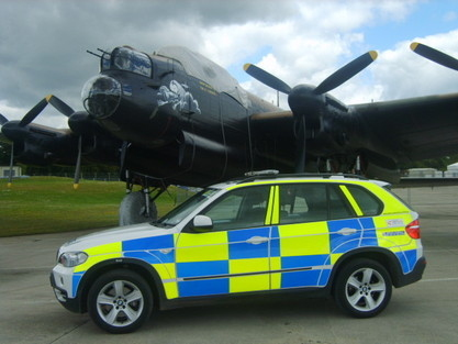 Royal International Air Tattoo, RAF Fairford, 2008/9 BMW X5 and a Lancaster Bomber . (Gloucestershire Police Archives URN 6078)