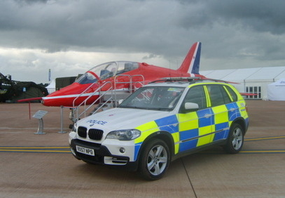 Royal International Air Tattoo, RAF Fairford, 2008/9 BMW X5 and a Red Arrow. (Gloucestershire Police Archives URN 6079)