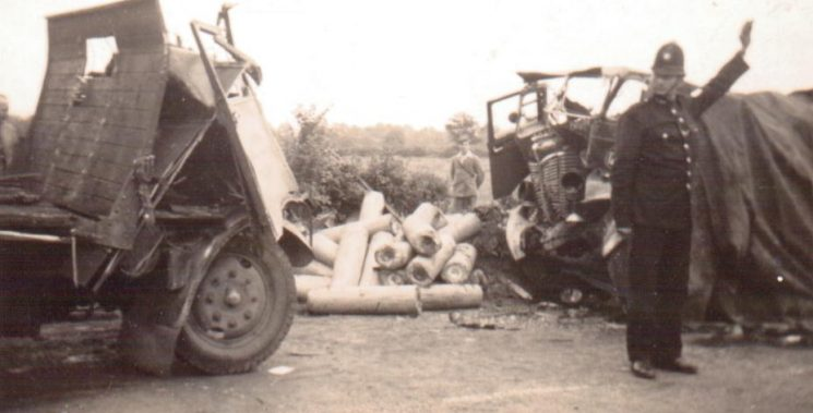 Road accident at Maisemore  in the early 1950s with an unidentified police officer directing traffic. (Gloucestershire Police Archives URN 1671-1)