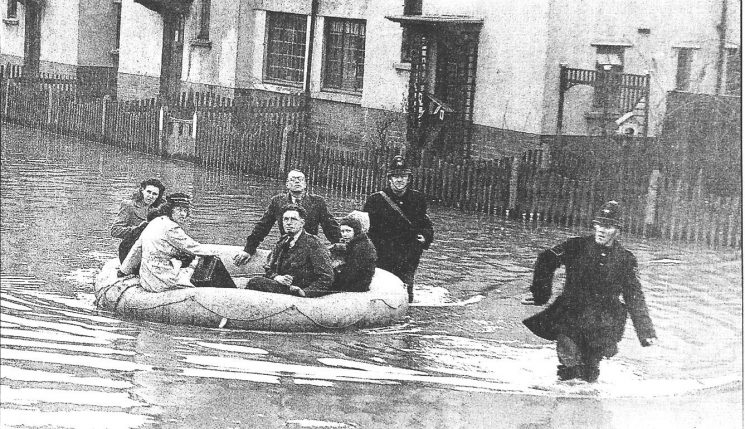 Police Sergeant S Elliott and unknown  Police Constable  rescuing residents of Deans Walk, Gloucester during  floods 1947. (Gloucestershire Police Archives URN 591)
