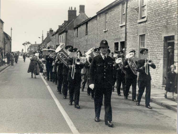 Police Constable Ken Barker  leading Marshfield Town Band on a parade through the town  1950. (Gloucestershire Police Archives URN 902)
