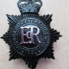 Black helmet plate from reign of Elizabeth II with queens crown 1953-79. (Gloucestershire Police Archives URN 6119)