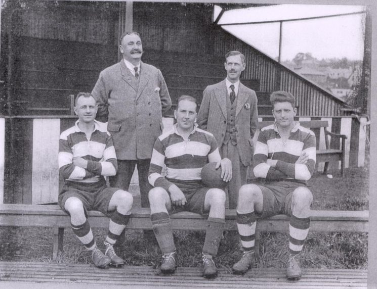 Gloucestershire Constabulary  members of Lydney Rugby Club Back row left  to right Superintendent  J.Shelswell MBE, Chairman; Police Sergeant Wilks, Secretary; Front row left  to right Police Constables F. Morris; F. Taylor, captain; D. Anderson (Gloucestershire Police Archives URN 1175)