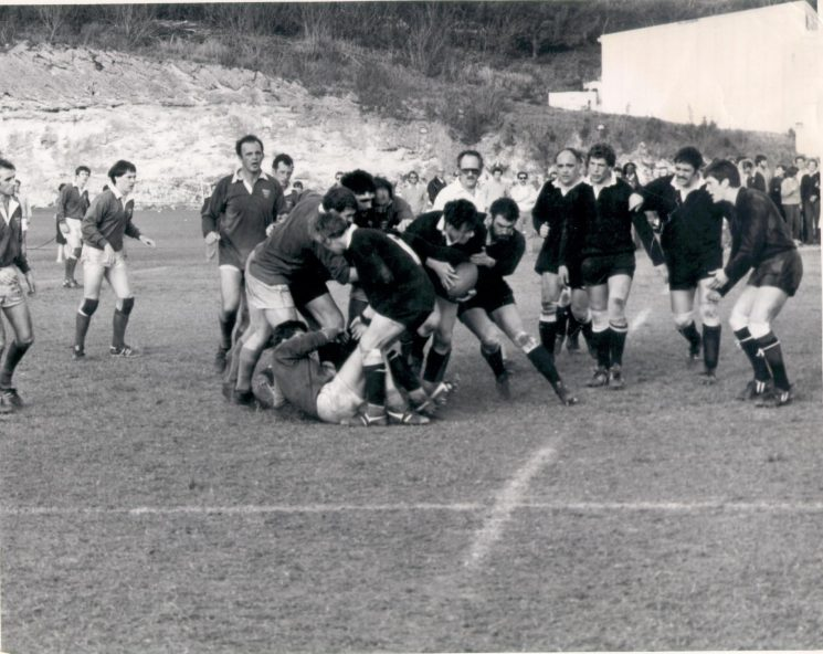 Gloucestershire Constabulary Rugby Football Team playing in Bermuda during their tour in 1982 Officers in photo - Michael Francis (carrying the ball), left to right Jerry Herniman , Glyn Radcliffe, unknown, Johm Fidler, Paul Gale (Gloucestershire Police Archives URN 1202)