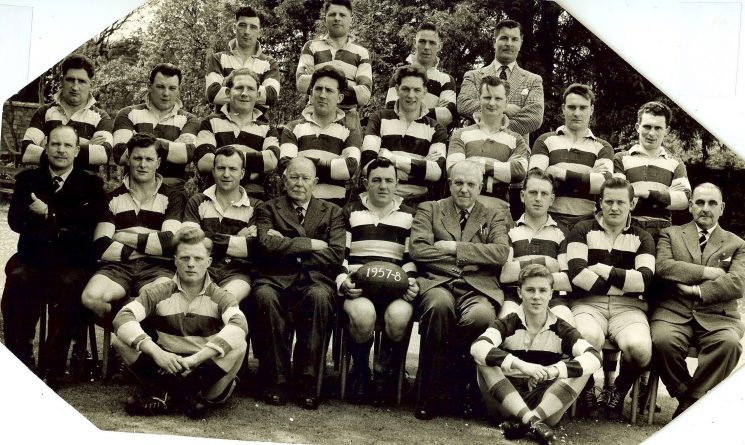 Gloucestershire Police Rugby Team 1957-58 Sitting Left to right: Bob Price ), Roger Pearce Front Row left to right : Fred (Alfred G) (Bomber) Harris; David Jones; Cyril Thomas; Chief Constable Henn; Jack Watkins (captain); deputy Chief Constable A H Carter ; R Willetts; unknown ; Jack Terry; Second row let to right : unknown; Don Say; Graham Watkins; John Day; Peter Scott : Gerald Hodder; unknown; unknown. Back Row L-R: Trevor Jones; ?; Bob Parfitt; Don Trapp (Gloucestershire Police Archives URN 1318)