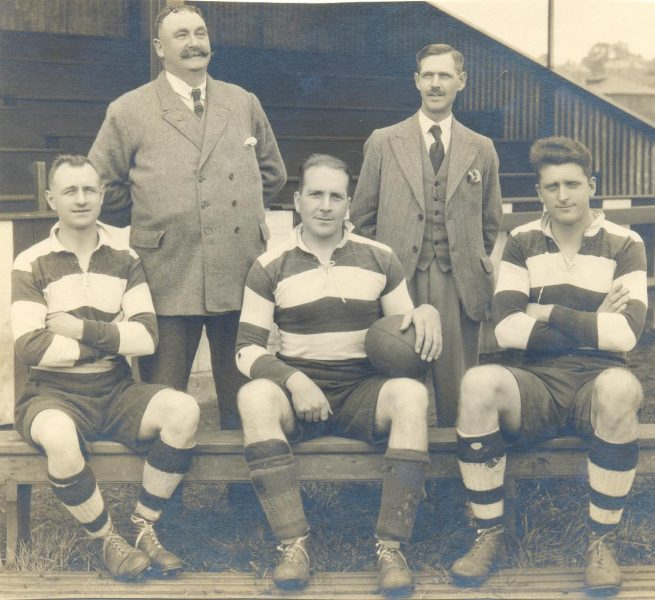 Gloucestershire Police Lydney rugby team. Standing left  to right -Superintendent Shellswell;  Police Sergeant Wilkes. Seated left  to right - Police Constables Morris; Taylor; (Captain); Anderson (Gloucestershire Police Archives URN 1335)
