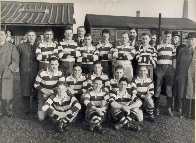 Gloucestershire Police rugby team. Back Row left to right: Chief Superintendent F Statham, Superintendent J Hallam, Police Constables Reg Matthews, Cambell Willetts,  Don Anderson, Cyril Thomas,  Alan Smith,  Fred Harris,  Reg Townsend, unknown, Inspector L Ryland, Police Constable Peter Blake, Detective Superintendent A Hancock, Chief Superintendent WE Wakefield, Middle Row left to right: Police Constables John Morrison,  Jim Hopkins, Detective Constable Frank Coombes,  Police Constables K Hudman,  Brian Marshall, Front Row Left to Right: Police Constable Eric Viles, Gordon Parker, Police Constable Bill Jelf. (Gloucestershire Police Archives URN 1401)