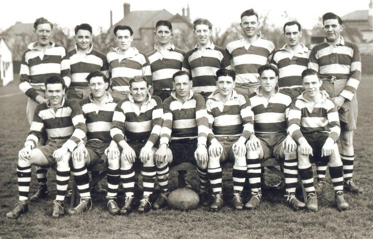Gloucestershire Police Rugby team Back row left to right :  Ivor Jones unknown; K Tuck; W (Bill) Jelf; Alan Wadley; Cam Willets; S Miles;  P. White. Front row left to right:  M Webley; Frank Coombes; Sid Dangerfield; Harry Gribble; J Jones; J Hopkins; R Parfitt (Gloucestershire Police Archives URN 1425)