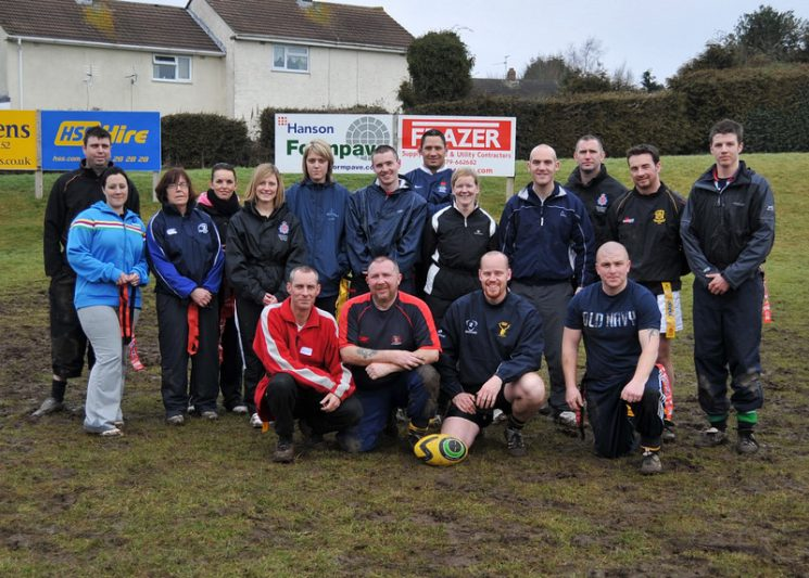Tag-rugby training at Cinderford Rugby Football Club to allow officers to go into primary schools and engage with young people.  This was in Spring 2010.  Organised by Police Constable  Duncan Sleeman Left to right standing; unknown, Police Community Support Officer Helen Devlin, Police Community Support Officer Dawn Teague, Police Community Support Officer Louise Borg-Littleton, Police Community Support Officer Lucy Webb, Police Community Support Officer Claire Long, Police Constable David Reynolds, Mike Panahoe Cinderford Rugby Football Club (Community coach) , Police Community Support Officer Sue Pritchard, Police Community Support Officer Nick Jones, Police Constable Duncan Sleeman, Damian (Street Warden Forest of Dean District Council) Police Community Support Officer Dan Wilce Kneeling: Police Community Support Officer Sean Clarke, Nick Brain (Street warden Forest of Dean District Council),Police Community Support Officer James Perarce, Jon Cooke (Street Warden Forest of Dean District Council. (Gloucestershire Police Archives URN 2143)