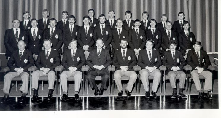 Chief Constable  LAG Soper with  members of the Force Rugby Team before the Rugby Tour of Bermuda Feb 1982 Back Row left to right :  Paul Smithson,  Brian Chandler, Mark Gimson  Win Morris, Robin Yates, Paul Gale, Mike Jones ,Gary Power. Roger Turley Middle row: Glyn Radcliffe,  Dave McFarlane, Mike Beer, John Fidler, Mike Francis, Geoff Brooks, Dave Stalker, Keith Richards, Eric Woodmason, Roy  Hopson, Harry Champion Front row: Pat Hatcher, Pete Sharpe, Don Wyman,  LAG Soper, Jerry Herniman, Clive Field, Terry Short, Ron Etheridge. (Gloucestershire Police Archives URN 358)