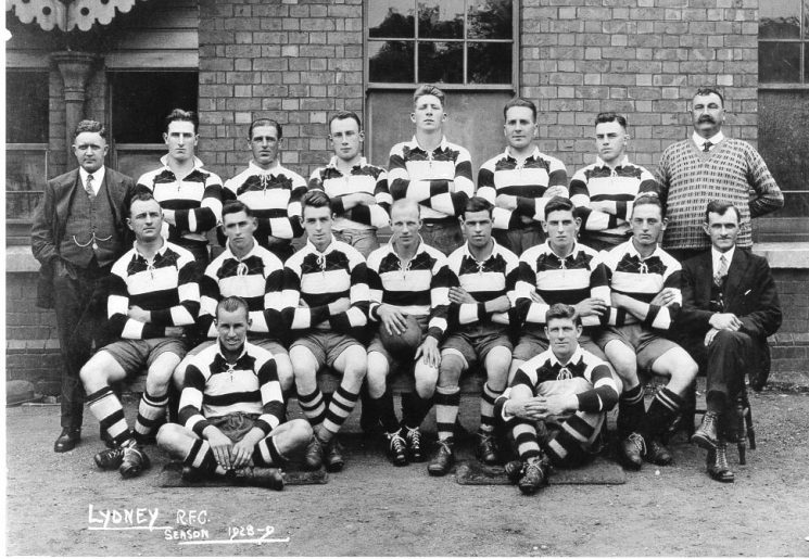 Lydney Rugby Football Club 1928/29 which includes Police Officers - Back row left to right No.6 Police Constable Fitzroy Frederick Taylor, No.8.Superintendent John Shellswell. Middle row left to right No.1.Police Constable  Frank Morris. (Gloucestershire Police Archives URN 590)