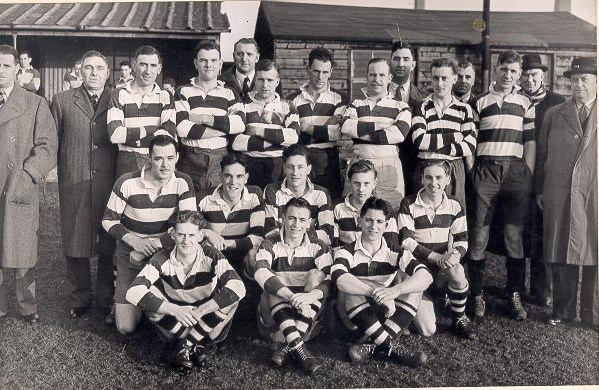 Gloucestershire Police Rugby Team around 1950. Back Row left to right Chief Superintendent F Statham, SuperintendentJ Hallam, Pc Reg Matthews, Police Constable Cambell Willetts, Police Constable s Don Anderson,  Cyril Thomas, Alan Smith,  Fred Harris, Reg Townsend, unknown, Inspector L Ryland, Police Constable Peter Blake, Detective Superintendent A Hancock, unknown, Middle Row left to right: Police Constables John Morrison,  J Hopkins, Detective Constable  Frank Coombes, Police Constables  K Hudman,  Brian Marshall, Front Row left to right: Police Constables  Eric Viles, Gordon Parker, Bill Jelf. (Gloucestershire Police Archives URN 611)