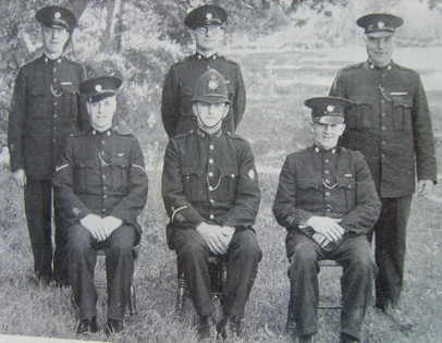 Woolaston Section - Forest of Dean Division Back row: Special Constables Beal, McLaren, Bucknell Front row: Head Special Constable Bollen, Police Constable Bayliss, Special Constable Williams (Gloucestershire Police Archives URN 6952)