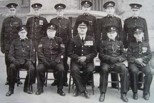 The Cheltenham Central Mobile Section Back row: Special Constables Gooch, O'Niell, Murphy, Dangerfield, Heathfield, Dennis Front row: Special Constable James, Special Sergeant Dodwell, Superintendent Hopkins, Special Constable Tandy, Special Constable Oates. (Gloucestershire Police Archives URN 6951)