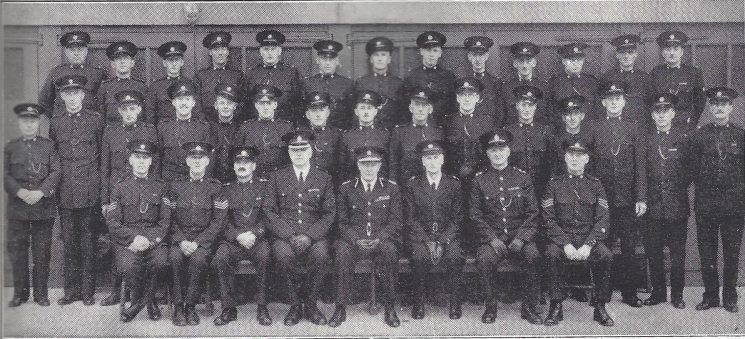 Staple Hill Section including Frenchay and Mangotsfield Subsections. Back Row: Special Constables Andrews, Bateman, Cox, Cranfield, Higginbotham, King, Matthews, Marshall, Guest, Hedges, Jefferies. Head Special Constable Gibbs, Special Sergeant Green. Middle Row: Special Constables England G, Thomas, Hall, England V, Britton, Frankcom, Miller, Palmer. Head special Constable Hood, Special Constables Swaffield, Mapstone, Harding, Pearce, Dent, Boyeldieu. Seated: Special sergeants Hamilton, Reed, Special Insprctor Young, Superintendent Carter, Chief Constable, Special Superintendent Giles, Inspector Wearing, Special Sergeant Ball. (Gloucestershire Police Archives URN 6955)