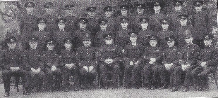Staple Hill Section Kingswood and Warmley. Back Row: Special Constables Letherby, Jenkins, Isaacs, Hacker, Bush, Wiltshire, Burchell, Stone, Hodge, Dascombe. Middle Row: Special Constables Morgan, Hopkins, Messenger, White, Thomas, Waddell, Fudge, Rogers. Seated: Special Constable Yeoman, Head Special Constable White, Special Sergeants Bryant, Silverthorn, Police Sergeant Willis, Inspector Bridges, Special Superintendent Giles, Special Inspector Williams, Special sergeant Sheppard, police Constable Gowing, Special Constable  Bailey,(Gloucestershire Police Archives URN 6956)