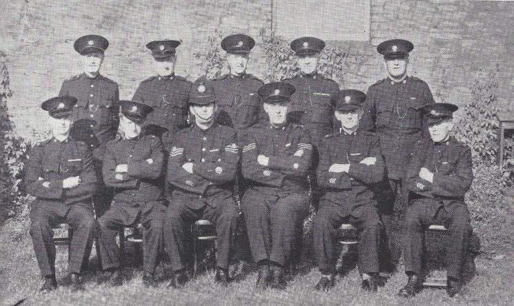 Staple Hill Division Hanham Section. Back Row: Police War Reserve Singer, Special Constables Grubb, Irwin, Lane, Belt. Front Row: Special Constables Morgan, Taylor, Police Sergeant Archer, Special Sergeant Wells, Special Constables Smith, Wride.(Gloucestershire Police Archives URN 6958)