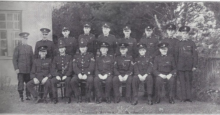 Thornbury Division Almondsbury Section. Back Row: Special Constables Hinton, Champion, Shellard, Evans, Moras, Tombs, Waite, Breadmore, Hulbert. Front Row: Special Constable Foot, Police Constable South, Police Sergeant Jayne, Special inspector Rabley, Special Sergeant Hills, Head Special Constable Hulbert, Special Constable Smith. (Gloucestershire Police Archives URN 6959)