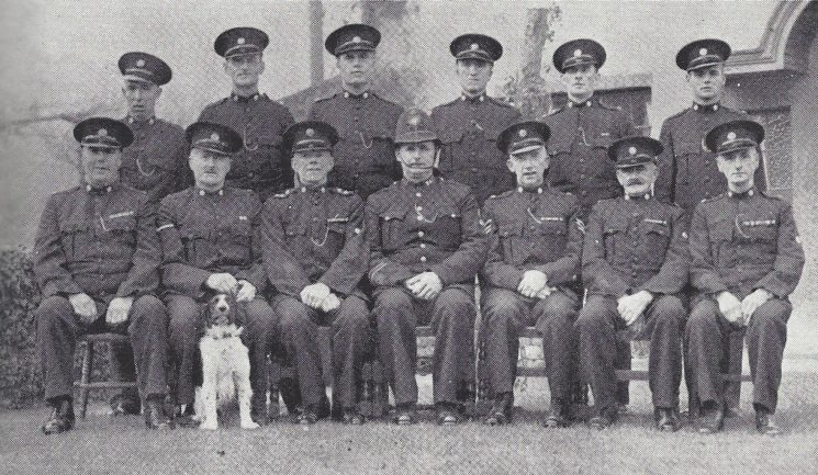 Thornbury Division Alveston Section. Back Row: Special Constables Bubb, Davis, Lewis, Cryer, niblett, Cole. Front Row: Special Constable Williams, Head Special Constable Homan, Special Inspector Rabley, Police Constable Keane, Special Sergeant Cullimore, Special Constables Gazzard, Dodd. (Gloucestershire Police Archives URN 6960)