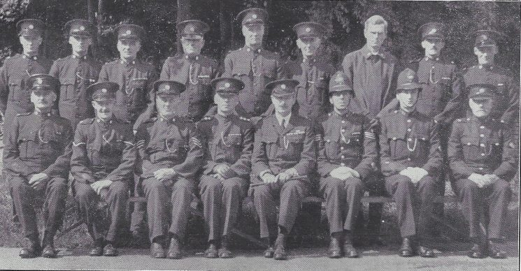 Thornbury Division Didmarton Section Back Row: Special Constables Tuck, Farmiloe, Watts, griffin, Chappel, Rodway, Wilkinson, parsons, Hatherel. Seated: Special Constable Cooper, head Special Constable  Clark, Special Sergeant Coombs, Special Inspector Brewer, Special Superintendent Rooke, Police Sergeant Auger, Police Constable Holtham, Police War Reserve Jones (Gloucestershire Police Archives URN 6964)