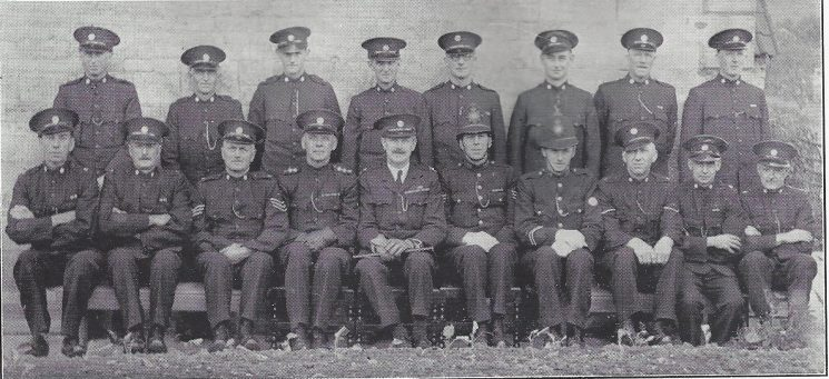 Thornbury Division Hawkesbury Section Back Row: Special Constables Bezar, Stinchcombe P.G, Parker, Watts, Bush, Hodges, Chitts, Chappell. Seated:Special Constables Davey, Daniell, Special Sergeant Coombs, Special Inspector Brewer, Special Suerintendent Rooke, Police Sergeant Auger, Police Constable Lane, Head Special Constable Baker, Special Constables Ranger, Stinchcombe. (Gloucestershire Police Archives URN 6967)