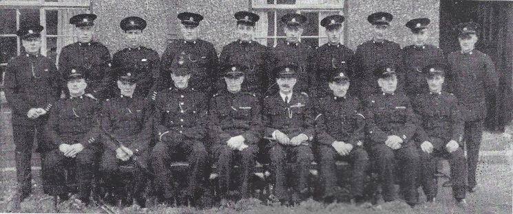 Thornbury Division Pilning Subsection Back Row: Special Constables Wood, Hardwell, Murray, Pope, Cook, Howse. Seated: Special Constable Ball, Head Special Constable Fisher, Police Constable Parry, Police War Reserve Osmond, Special Constable Lock. (Gloucestershire Police Archives URN 6971)