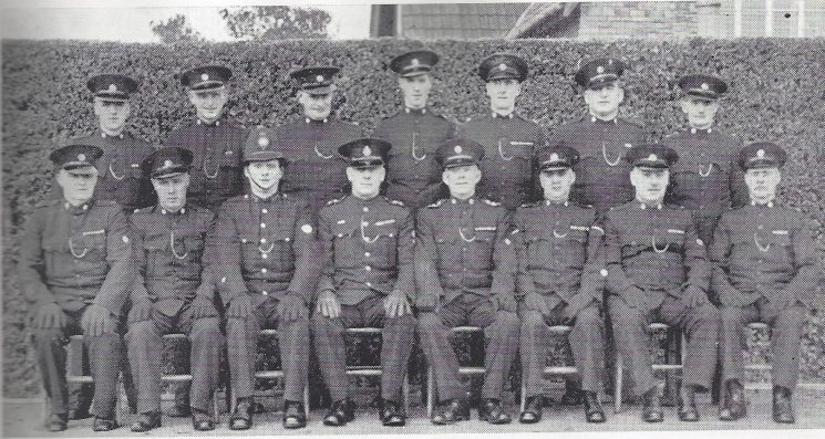 Thornbury Division Thornbury Section Back Row: Special Constables Ord, Brown, Pearce, Driscoll, Yarnold, Arnold, Driscoll. Seated: Special Constables Lambert, Walker, Police Constable Dimery, Inspector Midwinter, Special Inspector Rabley, Head Special Constable Thurston, Special Constables Cook, Garland.(Gloucestershire Police Archives URN 6973)