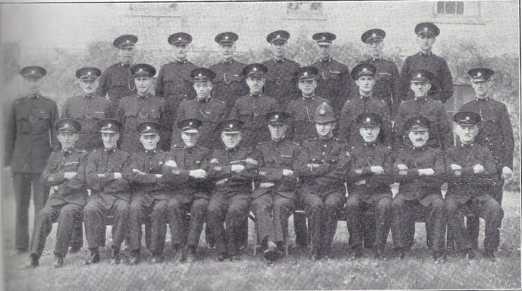 Thornbury Division Wick Section Back Row: Special Constables Gill, Hemborough, Packer W, Packer R, Watts, Dicks, Lucker. Middle Row: Special Constables Mizen, Beale, Drewett, Spill, Amos D, Bryant, Sprules, Stowe, Kidner. Seated: Special Constables Woodamn, Rossiter, Symes, Kembrey, Special Sergeant Orchard, Special Inspector Codrington, Police Constable Gill, Special Constables Snailum, Wright, Amos A. (Gloucestershire Police Archives URN 6974)
