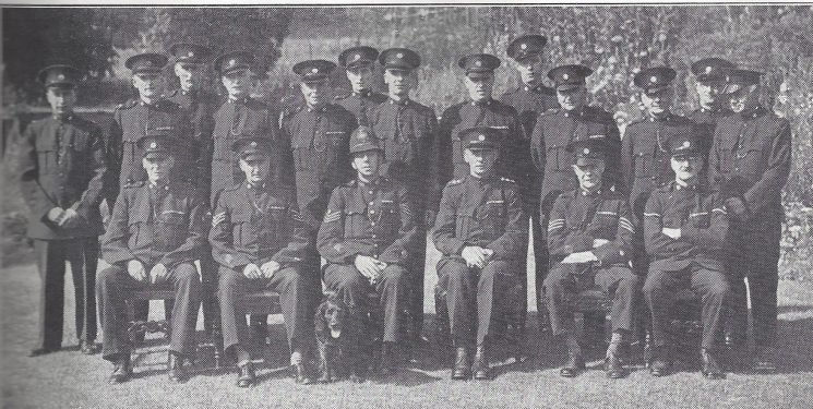 Thornbury Division Wotton under Edge Section Back Row; Special Constables Brant, Cornock, Sims, Baker. Middle Row: Special Constables Pullen, Colborn, Smith, Stinchcombe, Palmer, Hinder, Logan, Eves, Lindley. Seated: Special Constable Hall, Special Sergeant Keynton, Police Sergeant Auger, Special Inspector Brewer, Special Sergeant Jotcham, Head Special Constable Duffield.(Gloucestershire Police Archives URN 6977)