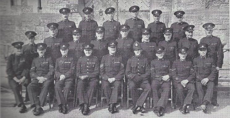 Cirencester Division Ampney Section Back Row: Special Constables Goodall, Stevens, Wyman, Peare, Law, Barnes. Middle Row: Special Constables Tokelove, Evans, Mustoe, Fielder, Cock, Robins, Adams, Banks, Strafford. Seated: Special Constable Day, Head Special Constable Stallworthy, Special Constable Venour, Inspector Newman, Special Sergeant MacLery, Police Constable Hardiman, Head Special Constables Hickman, Jobrins, Godwin.(Gloucestershire Police Archives URN 6978)