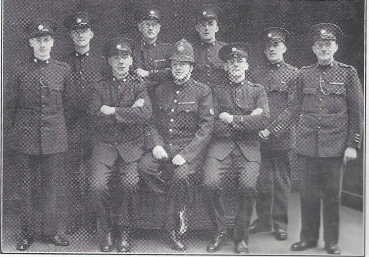 Cirencester Division South Cerney Back Row: Special Constables Wakefield, Peyman, Legg, Morgans W, Morgans S, Head Special Constable Cox. Seated: Special Constable Smith, Police Constable Waldron, Special Constable Miles. (Gloucestershire Police Archives URN 6980)