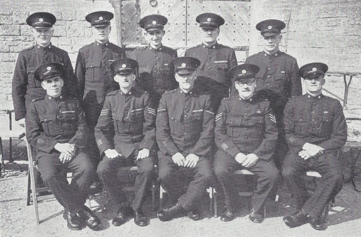 Cirencester Division Coln St Aldwyn, Hatherop and Quenington Sections. Back Row: Special Constables Sheppard, Barnett, Loving, Joynes, Twinning. Seated: Special Constable Bartlett, Special Sergeant Rickards, Head Special Constable Hutchings, Special Sergeant Baldwin , Special Constable Vincent. (Gloucestershire Police Archives URN 6982)