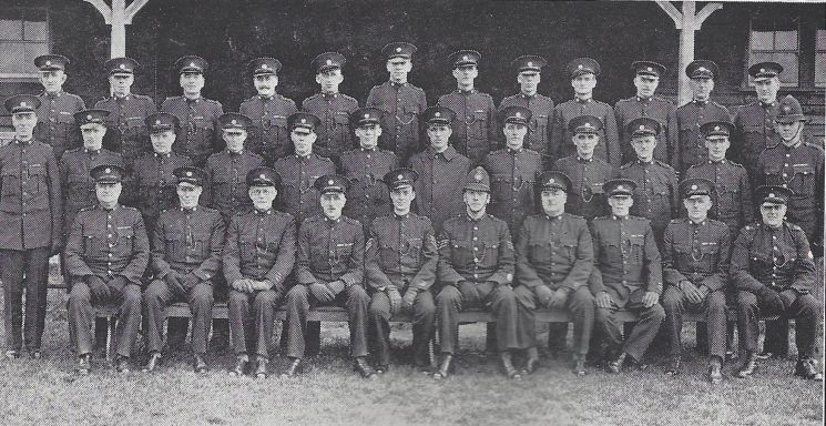 Cirencester Division Tetbury Sub Division. Back Row: Special Constables Dean, Mills, Eldridge, Berry, Perrin, Jones, Saunders, Roxbury, Lafford, Wheatley, Horton, Evans,. Middle Row: Special Constables Waters, Cox B, Holborrow, Watts, Walker, Hoad, Cox R, Neale A, Hancock, White, Mulcock, Police Sergeant Hawkins. Seated: Police War Reserve Davenport, Special Constables Gardiner, Neal, Head Special Constable Neale P, Special Sergeant Lewis, Police Sergeant Edmonds,Head Special Constables Godwin, Boulton Special Constable Butcher. Police War Reserve Witts. (Gloucestershire Police Archives URN 6983)