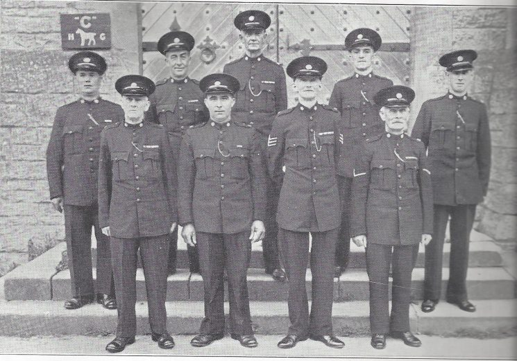 Cirencester Division Fairford Section Left to Right Special Constables Scriven L.S, Manning, Snuggs, Scriven F, Tolleyy Special Sergeant Rickards, Special Constable Westbury, Head Special Constable  Hope, Special Constable Bailey.(Gloucestershire Police Archives URN 6985)