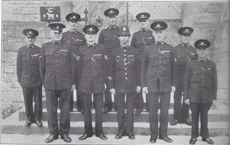 Cirencester Division Lechlade Section Left to Right: Special Constable Cox, Head Special Constable Gantlett, Special Constable Ford, Special Sergeant Rickards, Special Constable Chapman, Police Constable Bleaken, Special Constables Norris, Harrison, King, Shepherd. (Gloucestershire Police Archives URN 6986)