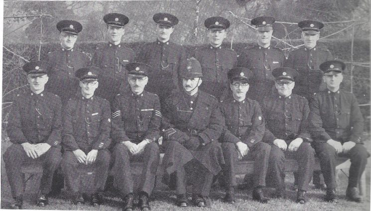 Stroud Division Brimscombe Section. Back row: Special Constables Fowler, Dowdeswell, Butler, Brown, Smith, Dawson Seated: Special Constables Barnfield, Webb, Special Sergeant Lambert, Police Constable Russell, Head Special Constable Orchard, Special Constables Bennett, Palfrey. (Gloucestershire Police Archives URN 6992)